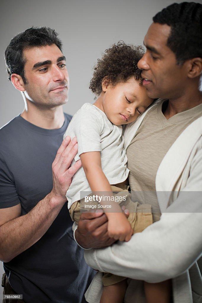 Men with sleepy child