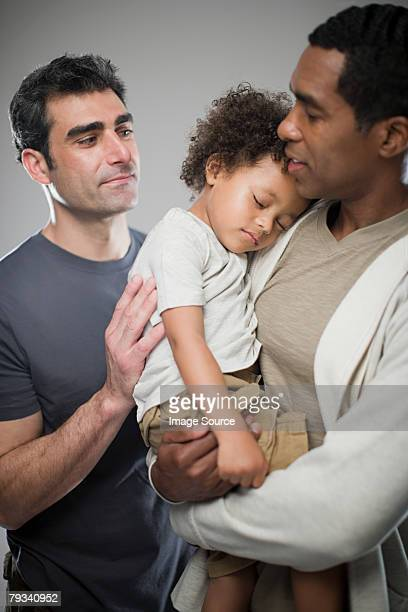 Men with sleepy child