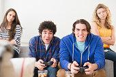 Men with video games ignoring girlfriends