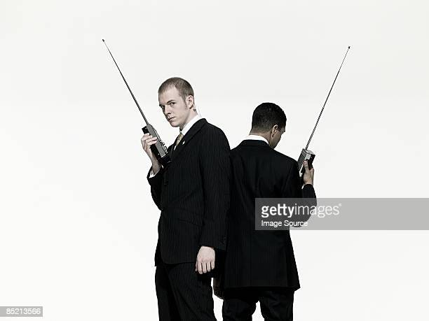 Men with walkie talkies