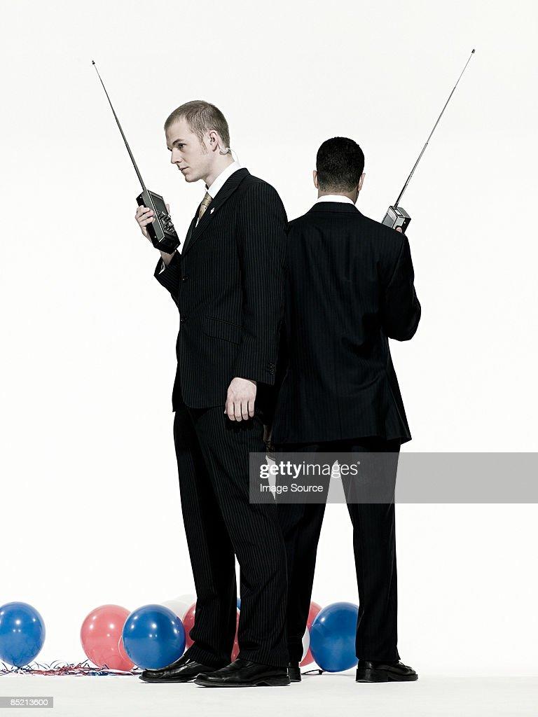 Men with walkie talkies : Stock Photo