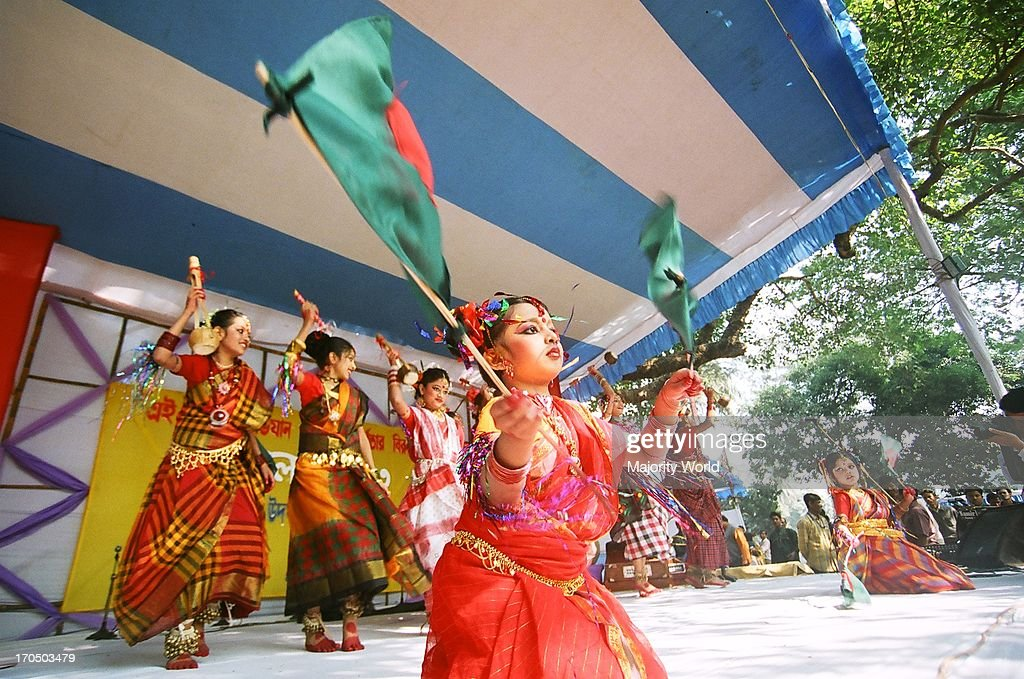 Men, women and children sing and dance at a rally that starts from the Institute of Fine Arts to celebrate the occasion of Nobanno Utshob or Harvest Festival that takes place every year in November. Dhaka, Bangladesh.