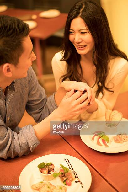 Men wooed the woman in the restaurant
