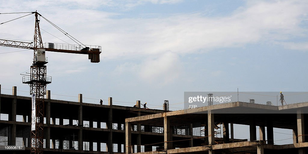 Men work at a construction site on May 25, 2010 in Cali, Colombia.