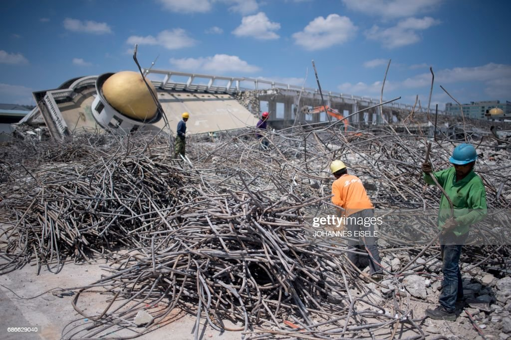 Men Work At The Demolition Site Of The Jiuxing Furniture Market In The  Suburbs Of Shanghai