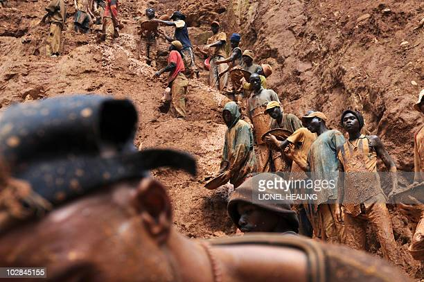 Men work in a gold mine on February 23 2009 in Chudja near Bunia north eastern Congo The conflict in Congo has often been linked to a struggle for...