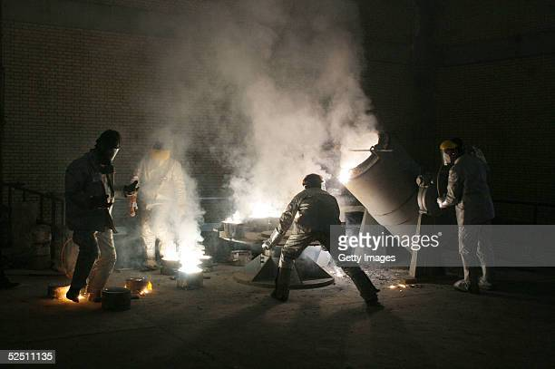 Men work inside of an uranium conversion facility March 30 2005 just outside the city of Isfahan about 254 miles south of capital Tehran Iran The...