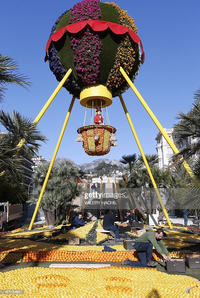 Men work on 'La Montgofiere' a sculpture made of oranges and lemons, on February 15, 2013 in Menton on the French Riviera, ahead of the start of the 'Fete du Citron' (lemon carnival). The theme of this 80th edition, running from February 16 until March 6, 2013, is 'Le Tour du monde en 80 jours' (80 days around the world). AFP PHOTO / VALERY HACHE
