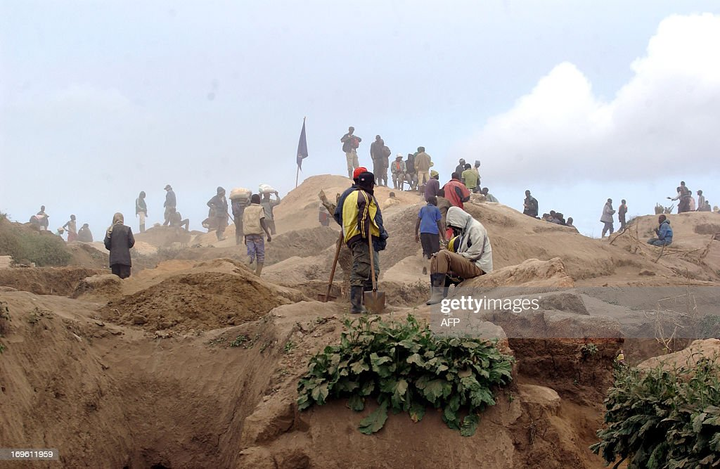 Men work on May 28 2013 at the Mudere mine near Rubaya some 9 kms from the eastern Democratic Republic of Congo city of Goma digging for cassiterite...