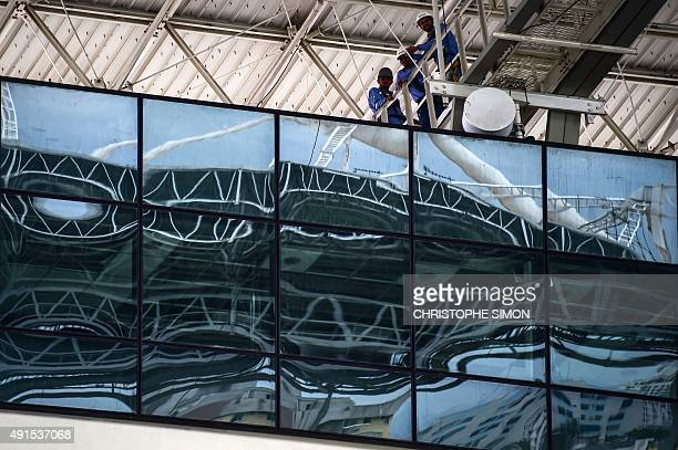Men work on refurbishing at the Engenhao Olympic Stadium in Rio de Janeiro Brazil on October 6 2015 The stadium will be used during the Rio 2016...