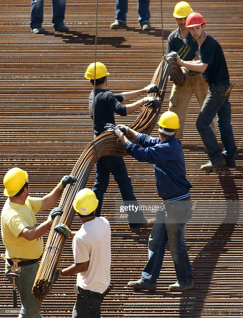 Men work on the construction site of the Marienplatz-Galerie shopping center on June 2, 2010 in Schwerin, northeastern Germany. German unemployment fell sharply in May 2010, data from the national labour agency showed.