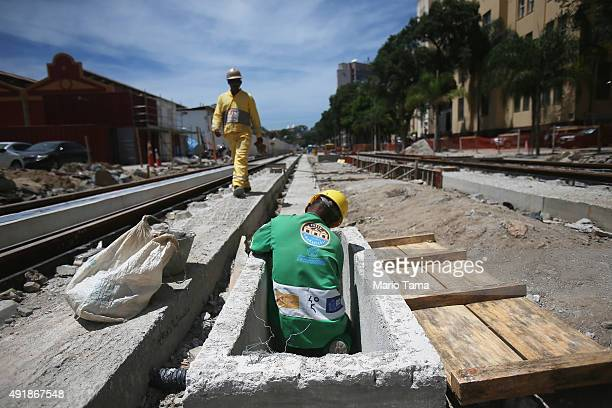 Men work on the new VRT light rail line in the Port District part of the new 'Porto Maravilha' project on October 8 2015 in Rio de Janeiro Brazil The...