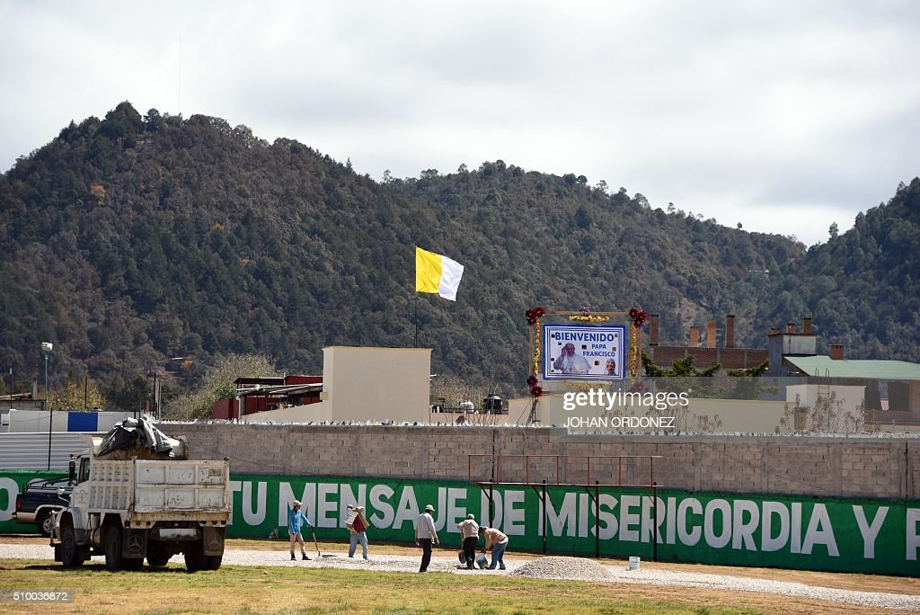 Men work on the site where Pope Francis will officiate an open-air mass at the Centro Deportivo Municipal (Municipal Sport Center) in San Cristobal de las Casas, Chiapas State, Mexico on February 13, 2016. ope Francis urged Mexican bishops Saturday to take on drug trafficking with 'prophetic courage,' warning that it represents a moral challenge to society and the church. AFP PHOTO/Johan ORDONEZ / AFP / JOHAN ORDONEZ