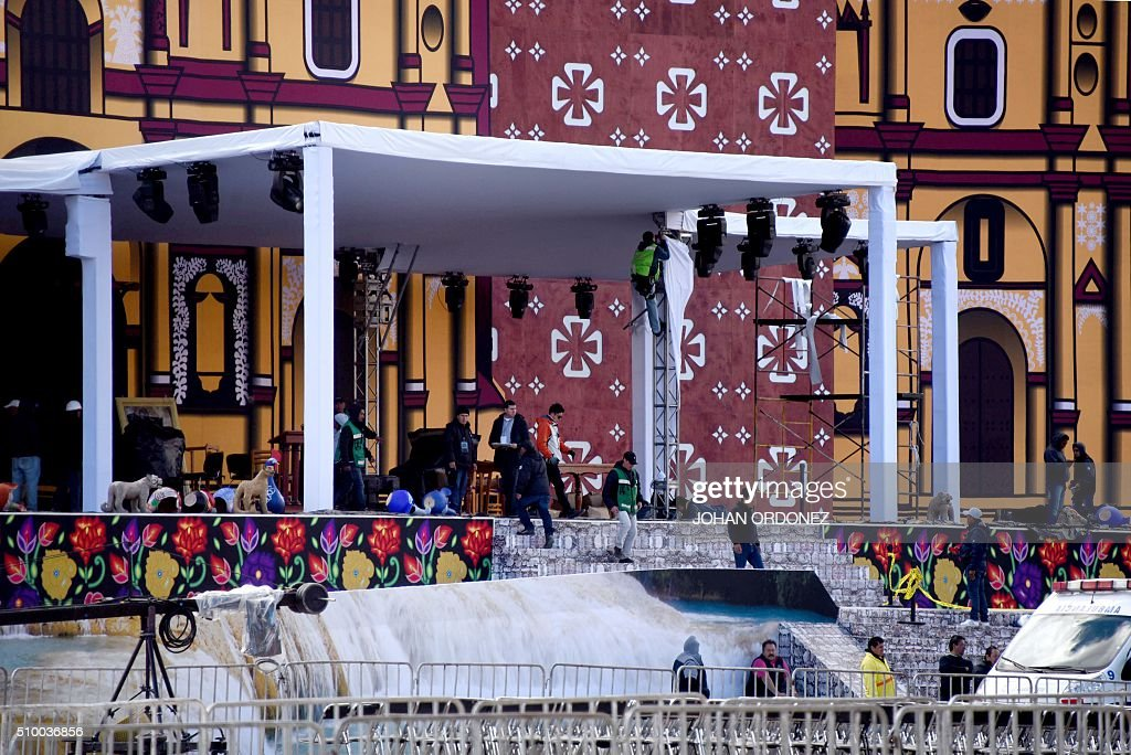 Men work on the stage from where where Pope Francis will officiate mass at the Centro Deportivo Municipal (Municipal Sport Center) in San Cristobal de las Casas, Chiapas State, Mexico on February 13, 2016. ope Francis urged Mexican bishops Saturday to take on drug trafficking with 'prophetic courage,' warning that it represents a moral challenge to society and the church. AFP PHOTO/Johan ORDONEZ / AFP / JOHAN ORDONEZ
