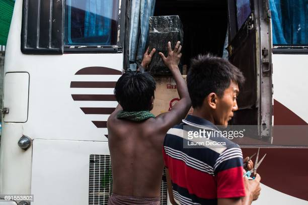 Men work to pack the monthly magazine distributed by the Masoeyein Monastery home of Wirathu into a cross country bus for delivery on June 1 2017 in...