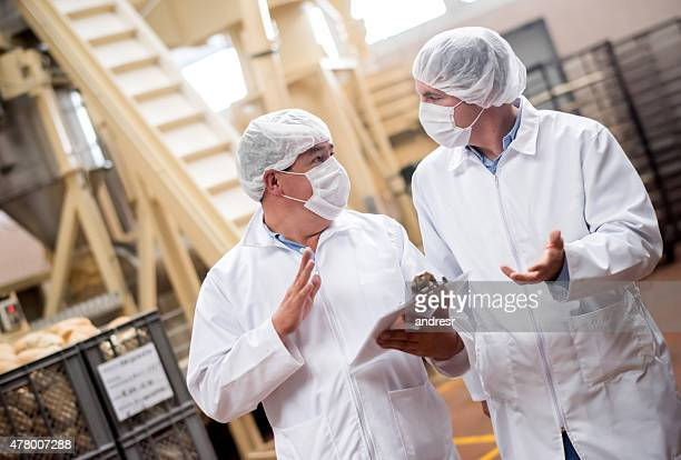 Men working at a food factory