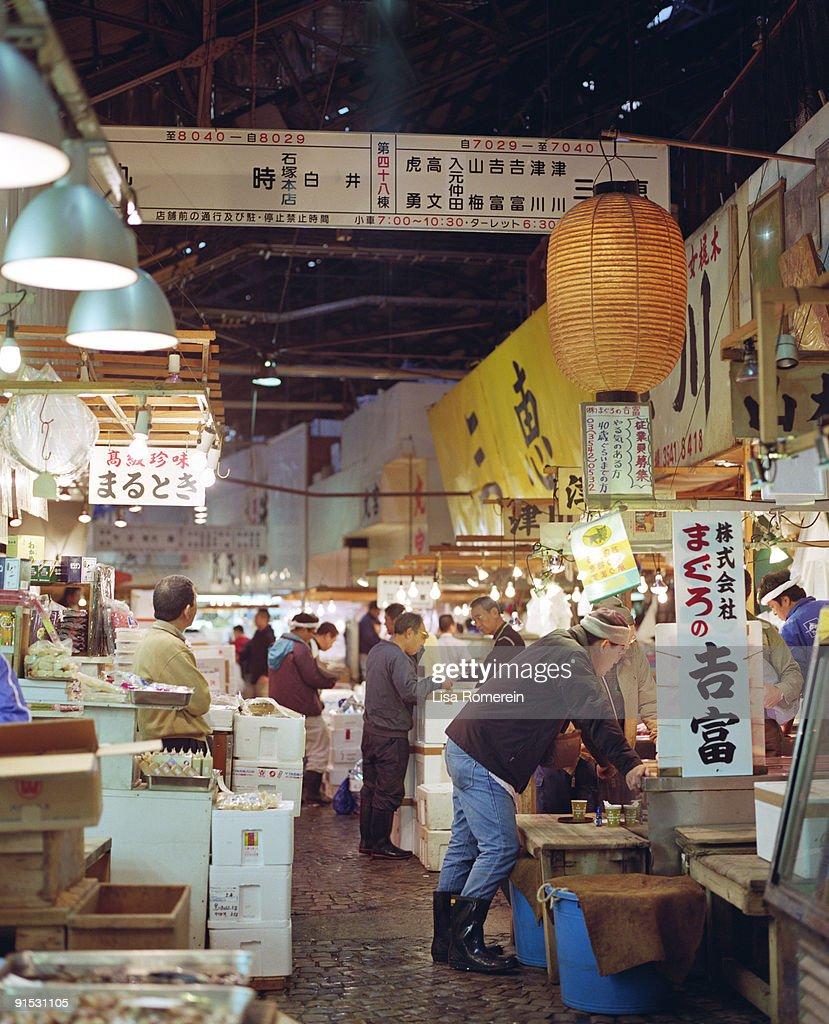 Men working at the Tsukiji fish market