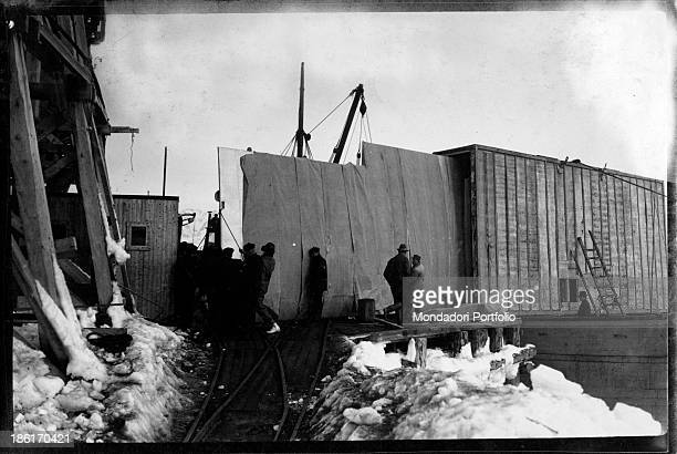 Men working in a yard during the Antarctic expedition led by Norwegian explorer Roald Amundsen in the polar regions Antarctica 1900s