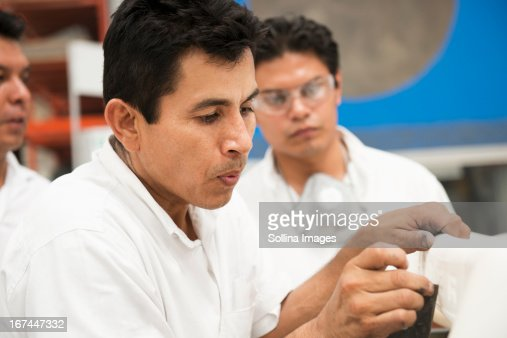 Men working in manufacturing plant : Stock Photo