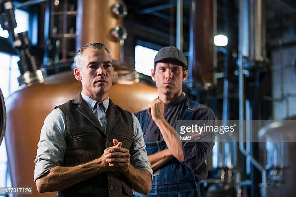 Men working in old distillery