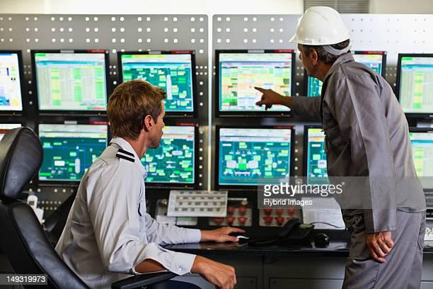 Men working in security control room