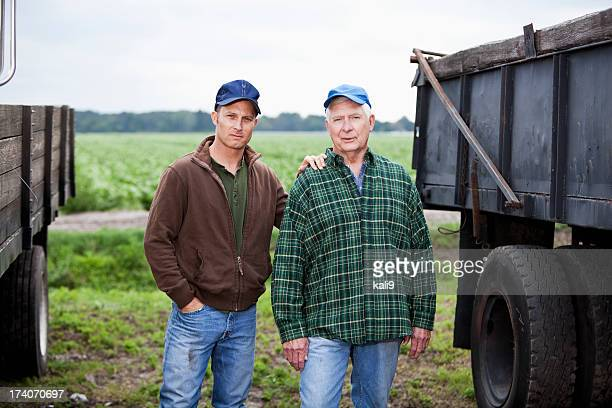 Men working on a potato farm, with trucks
