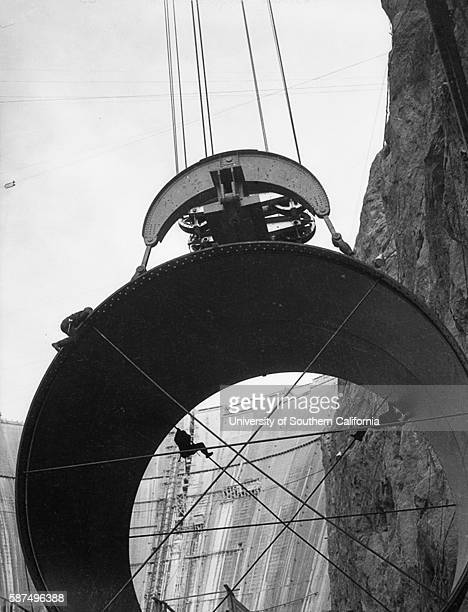 Men working on enormous pipe at the Hoover Dam site dw19344120867~10
