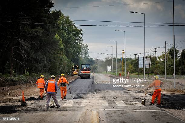 Men Working On Road