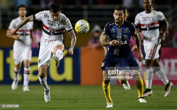 Mena of Sao Paulo fights for the ball with Lucas Lima of Santos during the match between Sao Paulo and Santos for the Brazilian Series A 2016 at...
