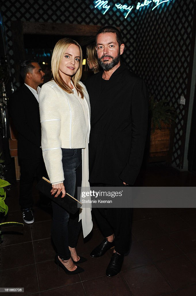 Mena Suvari (L) and Donald Oliver attend an intimate dinner event hosted by Elle magazine and J Brand at Petit Ermitage Hotel on September 25, 2013 in West Hollywood, California.