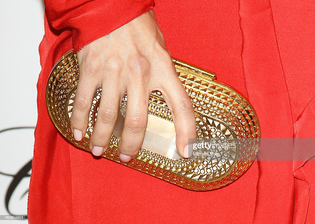 Mena Suvari (clutch detail) arrives at the 21st Annual Elton John AIDS Foundation Academy Awards viewing party held at West Hollywood Park on February 24, 2013 in West Hollywood, California.