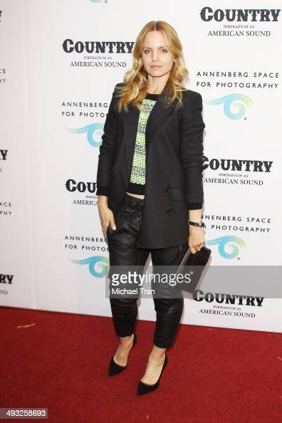 Mena Suvari arrives at the exhibit opening of 'Country Portraits Of An American Sound' held at Annenberg Space For Photography on May 22 2014 in...