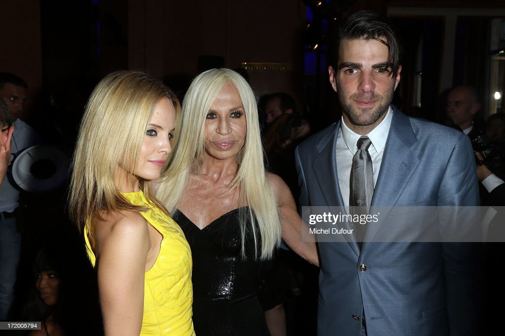 <a gi-track='captionPersonalityLinkClicked' href=/galleries/search?phrase=Mena+Suvari&family=editorial&specificpeople=156413 ng-click='$event.stopPropagation()'>Mena Suvari</a>, Donatella Versace and <a gi-track='captionPersonalityLinkClicked' href=/galleries/search?phrase=Zachary+Quinto&family=editorial&specificpeople=715956 ng-click='$event.stopPropagation()'>Zachary Quinto</a> backstage after the Versace show as part of Paris Fashion Week Haute-Couture Fall/Winter 2013-2014 at on June 30, 2013 in Paris, France.