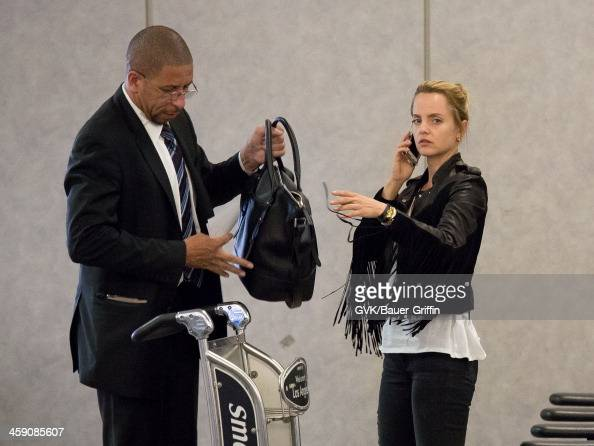 Mena Suvari stays hydrated as she arrives at LAX on September 11 2013 in Los Angeles California