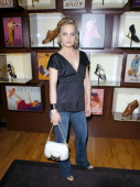 Mena Suvari wearing BALLY Bag and BALLY shoes during BALLY Retrospective Event with W Magazine and the Central Park Concervancy at Bally Flagship...