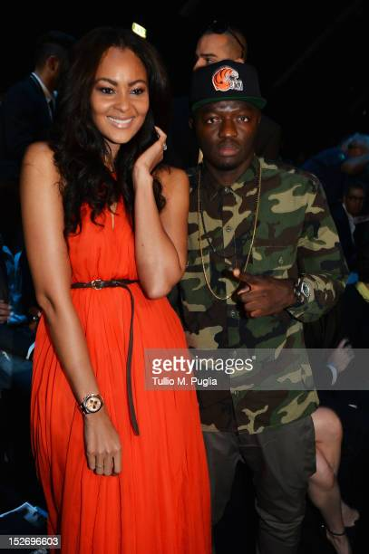 Menaye Donkir Muntari and Sulley Muntari attend the DSquared2 Spring/Summer 2013 fashion show as part of Milan Womenswear Fashion Week on September...
