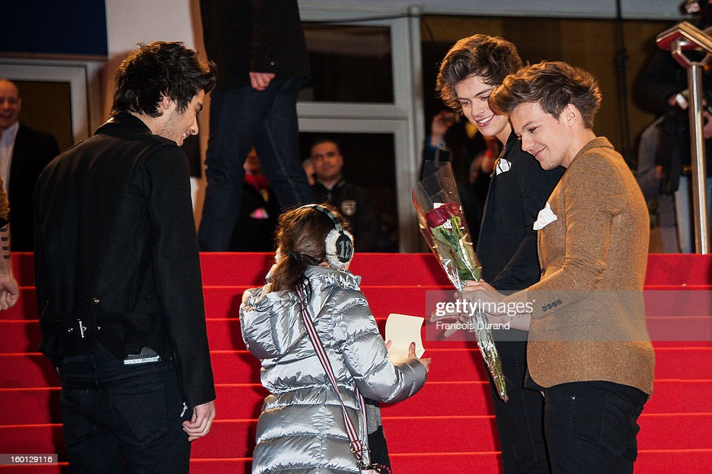 Menbers of band 'One Direction' Zayn Malik, Louis Tomlinson and Harry Styles attend the NRJ Music Awards 2013 at Palais des Festivals on January 26, 2013 in Cannes, France.