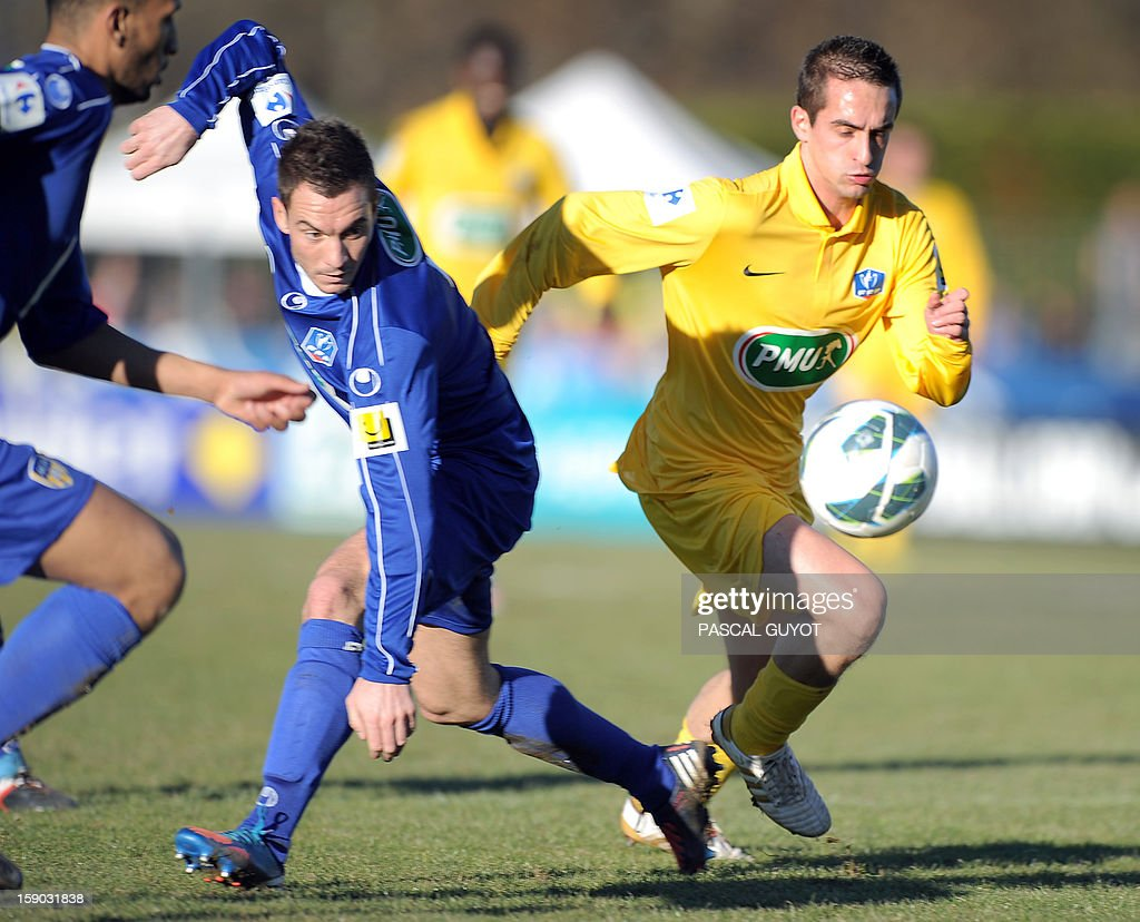 Mende's forward Nicolas Brunel (R) vies for the ball with Arles-Avignon defender Erwan Quintin (L) during the French Cup football match Mende vs Arles/Avignon at the Jean-Jacques Delmas stadium on January 6, 2013, in Mende.