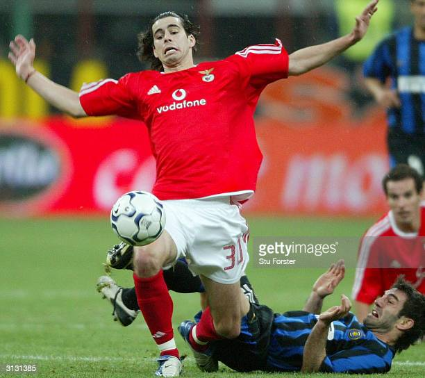 Mendes Tiago of Benfica is brought down in a challenge by Georgios Karagounis of Inter Milan during the UEFA Cup Fourth Round match between Inter...