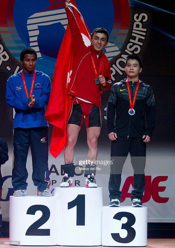 Mendoza of Colombia (L), Muammer Sahin (C) and Xiamend Wei of China receive their medals in the Men's 56kg award ceremony during day one of the 2013 Junior Weightlifting World Championship at Maria Angola Convention Center on April 04, 2013 in Lima, Peru.
