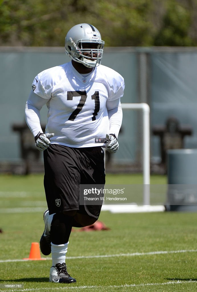 Menelik Watson #71 of the Oakland Raiders participates in drills during Rookie Mini-Camp on May 11, 2013 in Alameda, California.