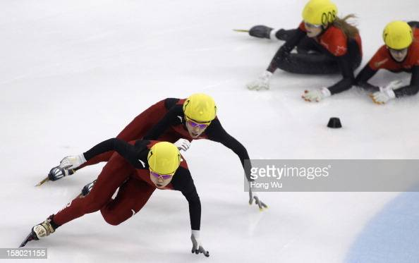 Meng Wang of China competes with Kexin Fan of China as Jessica Gregg and Marianne Stgelais of Canada fall down in the Women's 500m Final during the...