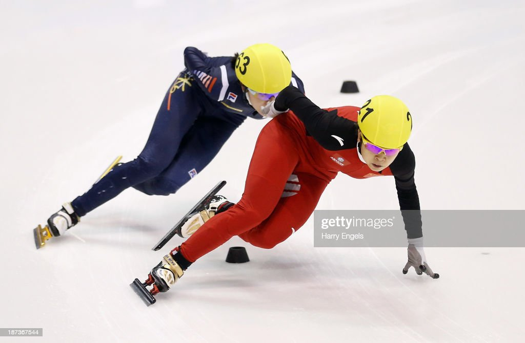 Meng Wang of China (R) leads Alang Kim of Korea during the Women's 1000m preliminaries on day two of the Samsung ISU Short Track World Cup at the Palatazzoli on November 8, 2013 in Turin, Italy.