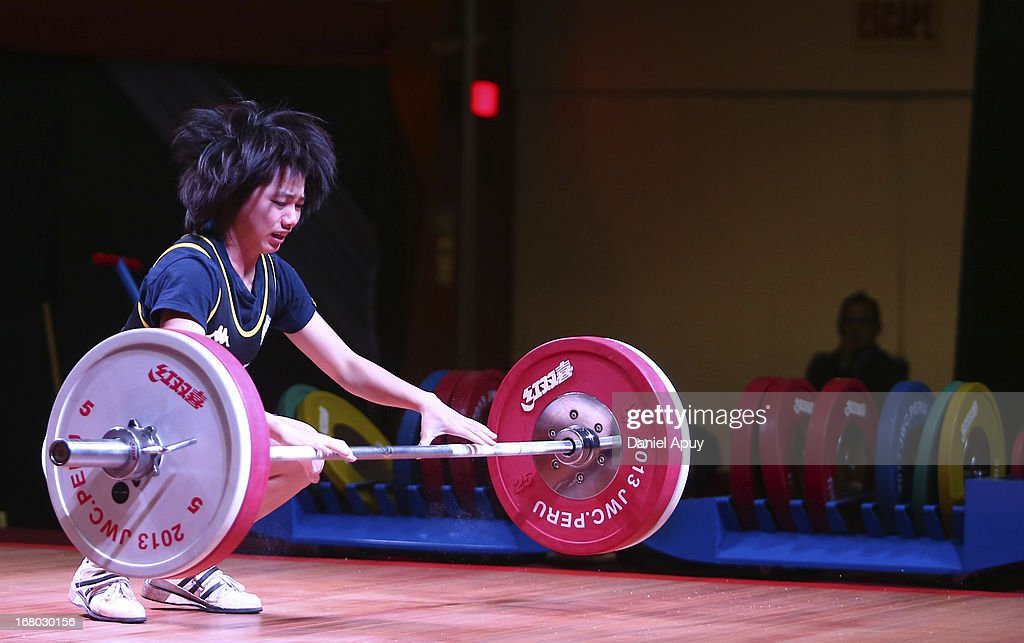 Meng-Chun Chiang of Chinese Taipei B competes in the Women's 48kg during day one of the 2013 Junior Weightlifting World Championship at Maria Angola Convention Center on April 04, 2013 in Lima, Peru.