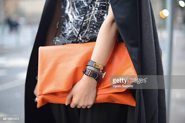 Mengdie Gin poses wearing a Rick Owens coat Alexander McQueen top and Hermes bracelet on January 17 2015 in Milan Italy