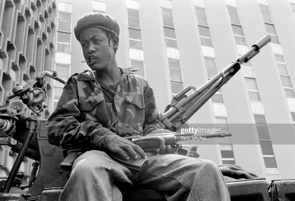 Mengistu Haile Mariam was the most prominent officer of the Derg, the military junta that governed Ethiopia from 1974 to 1987, and the President of the People's Democratic Republic of Ethiopia from 1987 to 1991. He oversaw the Ethiopian Red Terror of 1977-1978, a repression campaign against the Ethiopian People's Revolutionary Party and other anti-Derg factions. Mengistu fled to Zimbabwe in 1991 at the conclusion of a long rebellion against his government, and remains there despite an Ethiopian court verdict finding him guilty in absentia of genocide. Picture shows young soldiers of the EDPRF (Ethiopian Democratic People's Revolutionary Party) with their weapons in Addis Ababa after Mengistu fled to Zimbabwe.