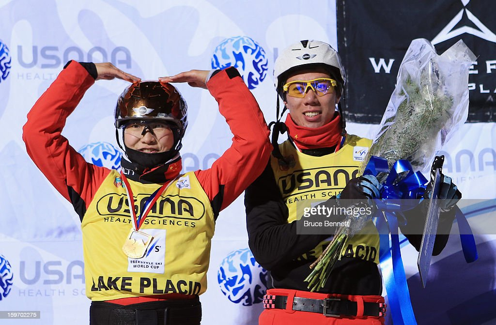 Mengtao Xu and Zongyang Jia both of China celebrate their victory at the Mens and Womens USANA Freestyle World Cup aerial competition at the Lake Placid Olympic Jumping Complex on January 18, 2013 in Lake Placid, New York.