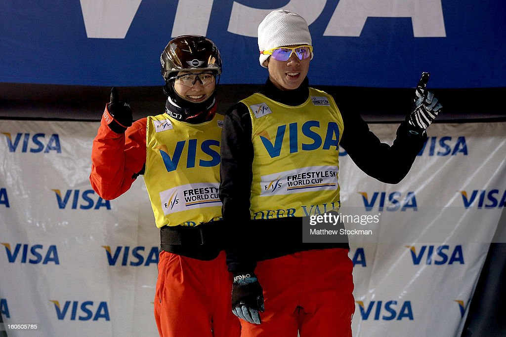Mengtao Xu #1 of China and Zongyang Jia #1 of China pose for photographers on the medal's podium after maintaining their yellow bibs after the Aerials competition during the Visa Freestyle International at Deer Valley on February 1, 2013 in Park City, Utah.