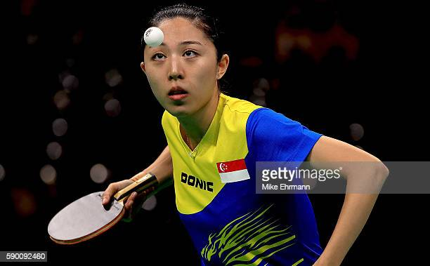 Mengyu Yu of Singapore plays a match against Ai Fukuhara of Japan during the Womens Team Bronze Medal match on Day 11 of the Rio 2016 Olympic Games...