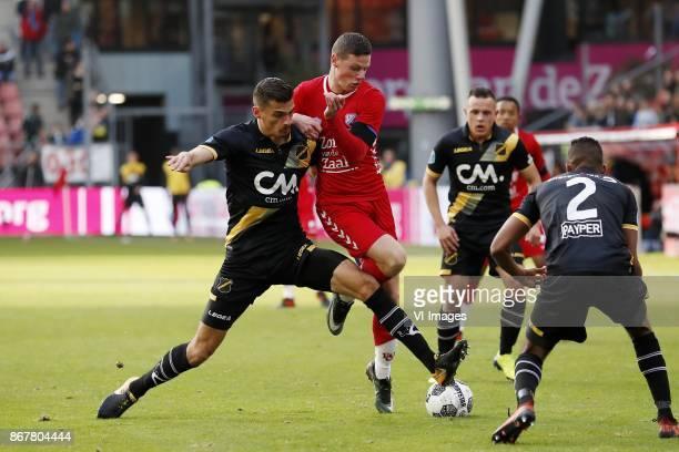 Menno Koch of NAC Breda Nick Venema of FC Utrecht Giovanni Korte of NAC Breda during the Dutch Eredivisie match between FC Utrecht and NAC Breda at...